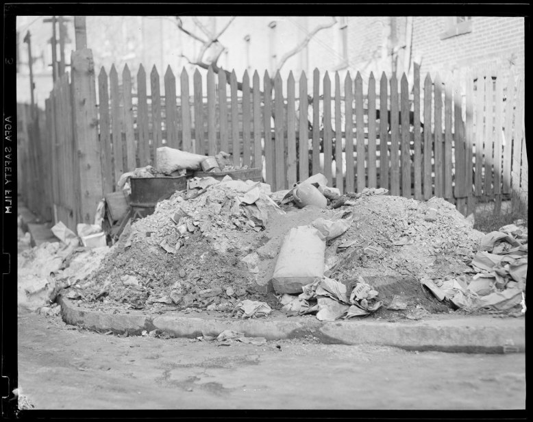 """Garbage in the Street. Photograph, 4"""" x 5"""". Leslie Jones, 1939. Boston Public Library, Print Department. This photo shows how certain areas, especially lower-income and minority neighborhoods, struggled to receive municipal sanitary services even well into the twentieth century."""