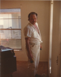 Richard Wilkens painting an apartment in Melbourne, Florida. Even when off the clock, he continued to wear the white uniform of a professional. Photograph. Ca. 1980. The Wilkens Family Collection.