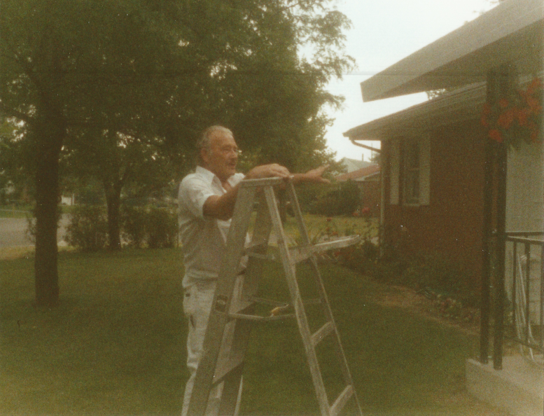 Richard Wilkens painting a cousin's house in Bowling Green, Ohio. Throughout his life as a painter, he always chose and cared for durable, long-lasting supplies. Photograph. Ca. 1986. The Wilkens Family Collection.