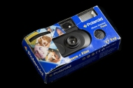 Disposable camera, Polaroid, late 1990's or early 2000's. Camera is essentially a plastic box with with a decorative cardboard case and film wound internally inside it. The camera's user handed the entire camera in to a photo services center. The center would develop the photos and then dispose of the plastic camera shell. Collection, Katherine C. Grier. - (Evan Krape / University of Delaware)