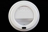 Traveler's lid for a disposable paper cup, Solo Cup Company, manufactured between 1990 and 2016. Made from Polystyrene. Collection, Katherine C. Grier. - (Evan Krape / University of Delaware)